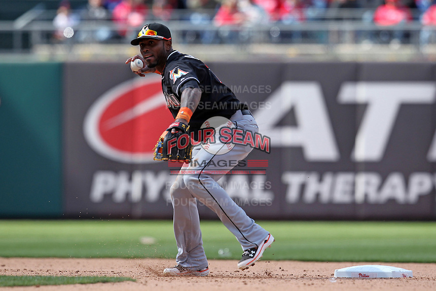 Miami Marlins shortstop Jose Reyes #7 throws to first during a game against the Philadelphia Phillies at Citizens Bank Park on April 9, 2012 in Philadelphia, Pennsylvania.  Miami defeated Philadelphia 6-2.  (Mike Janes/Four Seam Images)