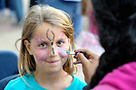 A girl gets her face painted before the CROP Hunger Walk, held October 27, 2013, in Raleigh, North Carolina.
