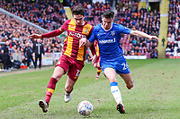 Alex Gilliead of Bradford City and Callum Reilly of Gillingham during the Sky Bet League 1 match between Bradford City and Gillingham at the Northern Commercial Stadium, Bradford, England on 24 March 2018. Photo by Thomas Gadd.