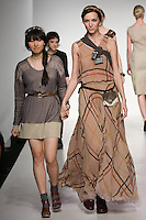 Senior fashion designer MaRu Jung, walks runway with model, at the close of the Pratt 2011 fashion show.