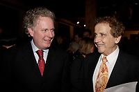 Jean Charest , Quebec Premier (L)<br /> Jesus Carles de Vilallonga, painter (R).<br /> <br /> Internationally  know artist J C de Vilallonga donated recent painting for a benefit sales for tyhose with menyal disabilities, held at Parisian laundry in <br /> Montreal, canada<br /> <br /> photo : (c) 2005 Images Distribution