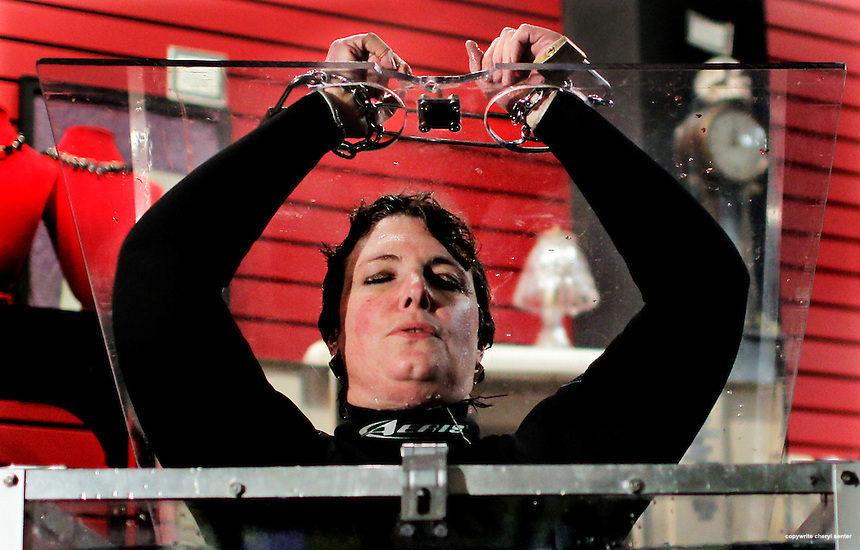 Escape artist Alexanderia the Great, aka Medway mother-of-three Donna Purnell does breathing excersizes before performing the 'Underwater Cell' escape act at Lydia's Carnival Sideshow in Salem, Ma, Saturday, Jan, 15, 2011.  Purnell created a new world record simply by doing the stunt in ope view for the audience.  Normally these types of stunts are done behind curtains.  (Cheryl Senter for the Boston Globe)