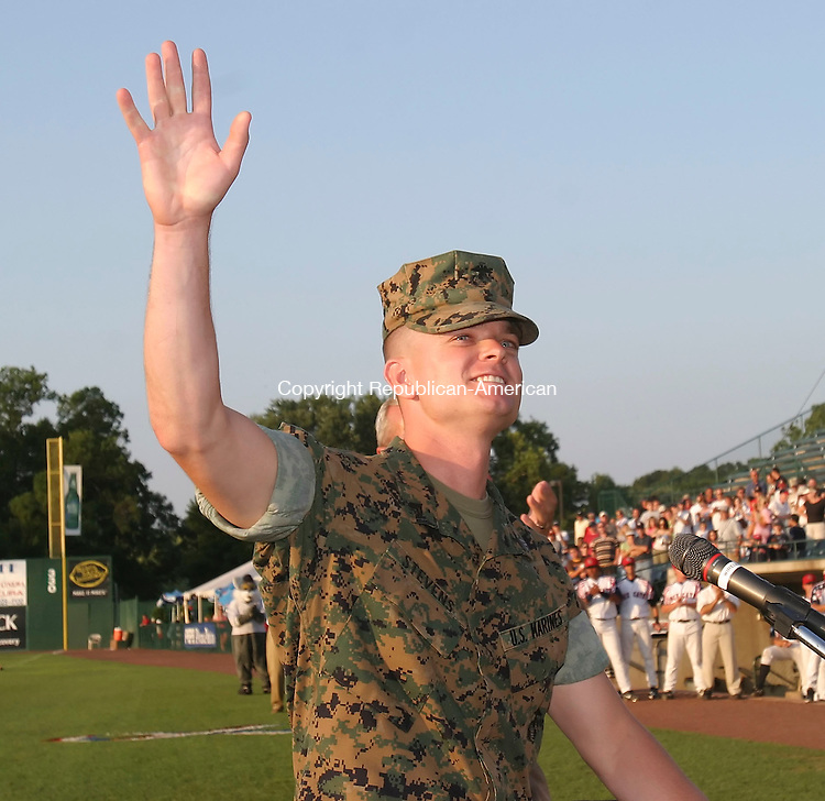 NEW BRITAIN,  CT 10 August 2005 -081005BZ11- Former New Britain Rock Cats shortstop and current Marine Cpl. Tony Stevens waves to the crowd while being honored for his military service before the game Wednesday.<br /> Jamison C. Bazinet Photo