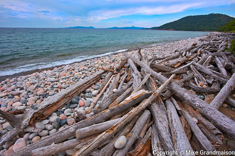 Rocks and driftwood on Pebble Beach. Lake Superior. <br />Marathon<br />Ontario<br />Canada