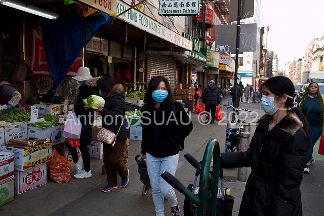 New York, New York<br /> March 18, 2020<br /> 12:53 PM<br /> <br /> Manhattan under coronavirus pandemic. <br /> <br /> Shoppers wearing face mask and gloves fearing the spread of the virus in downtown Manhattan.