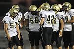Lawndale, CA 10/01/10 - Mickey O'crowley (Peninsula #53), Walt Proenca (Peninsula #56), Haden Gregory (Peninsula #42) and Joey Augello (Peninsula #58) in action during the Peninsula-Lawndale Varsity football game.