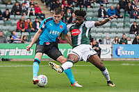 Bobby Grant of Fleetwood Town and Yann Songo'o of Plymouth Argyle during the Sky Bet League 1 match between Plymouth Argyle and Fleetwood Town at Home Park, Plymouth, England on 7 October 2017. Photo by Mark  Hawkins / PRiME Media Images.