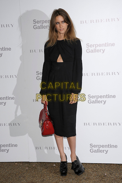 Jade Williams (Sunday Girl).Serpentine Gallery Summer Party, Kensington Palace Gardens, London 29th June 2011.full length black dress red handbag.CAP/PL.©Phil Loftus/Capital Pictures.