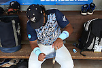 02 June 2016: Nova Southeastern's Andres Visbal works on his bat handle before the game. The Nova Southeastern University Sharks played the Cal Poly Pomona Broncos in Game 11 of the 2016 NCAA Division II College World Series  at Coleman Field at the USA Baseball National Training Complex in Cary, North Carolina. Nova Southeastern won the semifinal game 4-1 and advanced to the championship series.