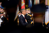 United States President Barack Obama (C) and Major General Michael S. Linnington (back C), Commander of the US Army Military District of Washington, are seen behind the silhouette of a military band while participating in a wreath-laying ceremony on Veteran's Day at the Tomb of the Unknown Soldier in Arlington National Cemetery, Arlington, Virginia, USA, 11 November 2012..Credit: Michael Reynolds / Pool via CNP