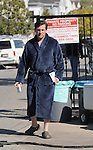 3-5-09 Exclusive.Steve Carell walking around in a blue bathrobe holding a hotdog  after filming a scene for the tv show The Office at a house in Los Angeles ca.  IN the scene steve was taking picture with a naked girl. B.J Novak was also on set with his new blond hair along with Jenna Fischer ....AbilityFilms@yahoo.com.805-427-3519.www.AbilityFilms.com.