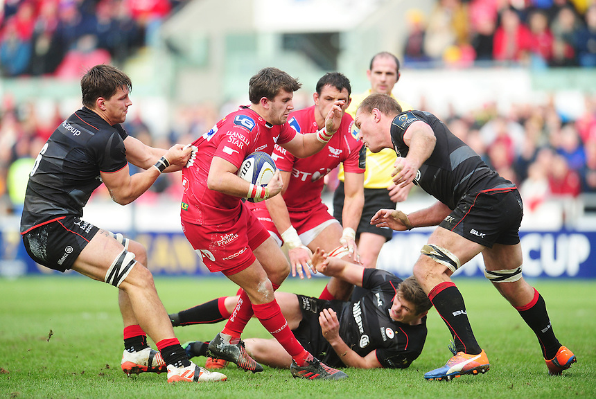 Saracens' Michael Rhodes gets to grips with Scarlets' Dan Jones<br /> <br /> Photographer Kevin Barnes/CameraSport<br /> <br /> European Rugby Champions Cup Pool 3 - Scarlets v Saracens - Sunday 15th January 2017 - Parc y Scarlets - Llanelli<br /> <br /> World Copyright &copy; 2016 CameraSport. All rights reserved. 43 Linden Ave. Countesthorpe. Leicester. England. LE8 5PG - Tel: +44 (0) 116 277 4147 - admin@camerasport.com - www.camerasport.com