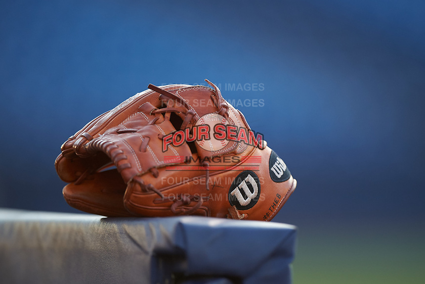 A glove rests on the dugout rail during an Arizona League game between the AZL Brewers Gold and AZL Brewers Blue on July 13, 2019 at American Family Fields of Phoenix in Phoenix, Arizona. The AZL Brewers Blue defeated the AZL Brewers Gold 6-0. (Zachary Lucy/Four Seam Images)