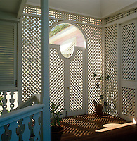 Trellis walls and doors ensure privacy and filter the strong Caribbean sunlight