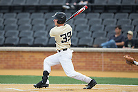 Ben Breazeale (39) of the Wake Forest Demon Deacons follows through on his swing against the Georgia Tech Yellow Jackets at David F. Couch Ballpark on March 26, 2017 in  Winston-Salem, North Carolina.  The Demon Deacons defeated the Yellow Jackets 8-4.  (Brian Westerholt/Four Seam Images)