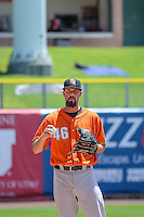 Mike Hauschild (46) of the Fresno Grizzlies warms up in the outfield before the game against the Salt Lake Bees in Pacific Coast League action at Smith's Ballpark on June 14, 2015 in Salt Lake City, Utah.  (Stephen Smith/Four Seam Images)