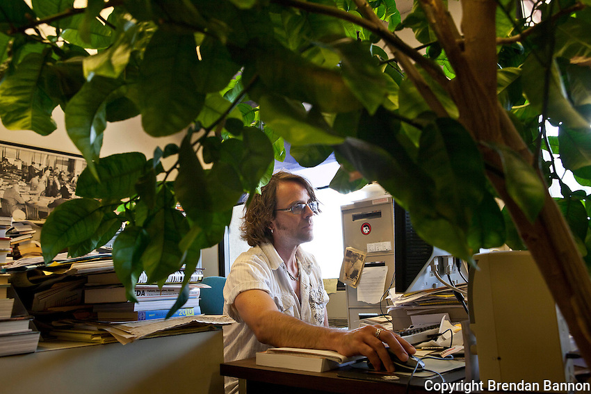 Buffalo News pop music critic Jeff Miers working at his desk.  The Buffalo News was the first newspaper owned by Warren Buffett. Mr. Buffett announced the purchase of 63 newspapers in May of 2012. Photo: Brendan Bannon, Buffalo, NY, June 8, 2012.
