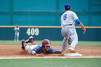 Frisco RoughRiders Charles Leblanc (12) dives back to the bag as first baseman Luke Persico (8) waits for a throw during a Texas League game against the Midland RockHounds on May 22, 2019 at Dr Pepper Ballpark in Frisco, Texas.  (Mike Augustin/Four Seam Images)