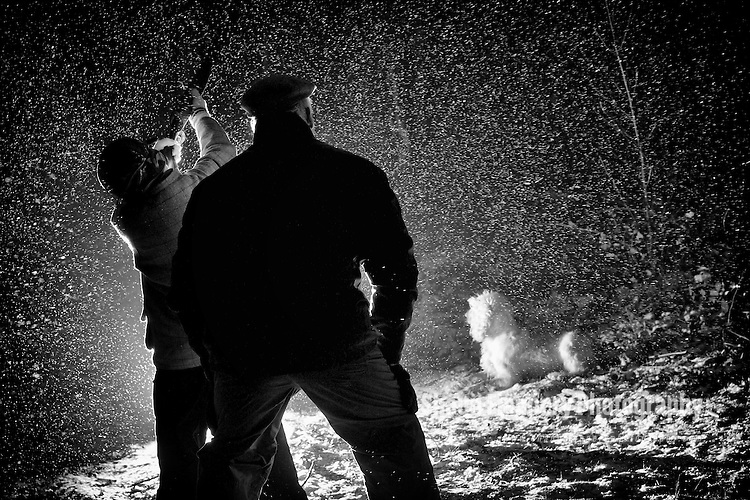 Pix: Shaun Flannery/shaunflanneryphotography.com...COPYRIGHT PICTURE>>SHAUN FLANNERY>01302-570814>>07778315553>>..4th February 2012……………..A gamekeeper watches over his son as he fires a 20 bore shotgun during a snow storm..Orange Roan Cocker Spaniel dog watches on.