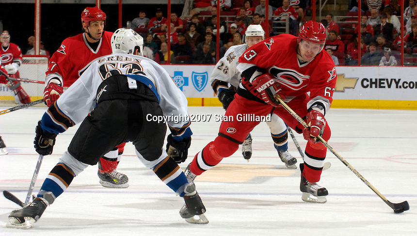 Carolina Hurricanes' Josef Vasicek tries to move past the Washington Capitals' Mike Green Thursday, March 22, 2007 at the RBC Center in Raleigh, NC. Carolina won 4-3.