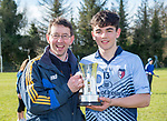 Scariff Community College player Mark Rodgers with his dad Ger who won a Harty medal with St Flannan's in 1987 following their All-Ireland Colleges final win over St Fergal's at Toomevara. Photograph by John Kelly.