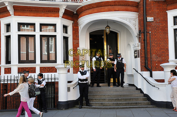 Ecuadorean embassy.demonstration in front of the Ecuadorean embassy in Knightsbridge, West London, England..August 17th, 2012.gv general view full length policemen police officers uniform black white stairs steps .CAP/BF.©Bob Fidgeon/Capital Pictures.