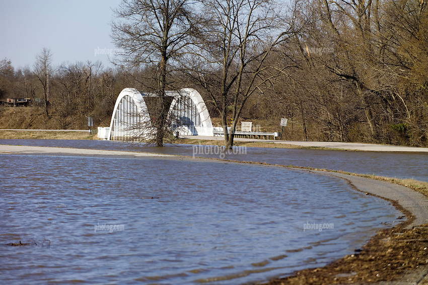 Bush Creek Marsh Arch Rainbow Bridge on Old Route 66 Riverton, KS. Flooded by a 100 Year Flood on 20 March 2008. View of both roadways, bridge access and adjacent road, underwater, view South-Southwest, north of the bridge.