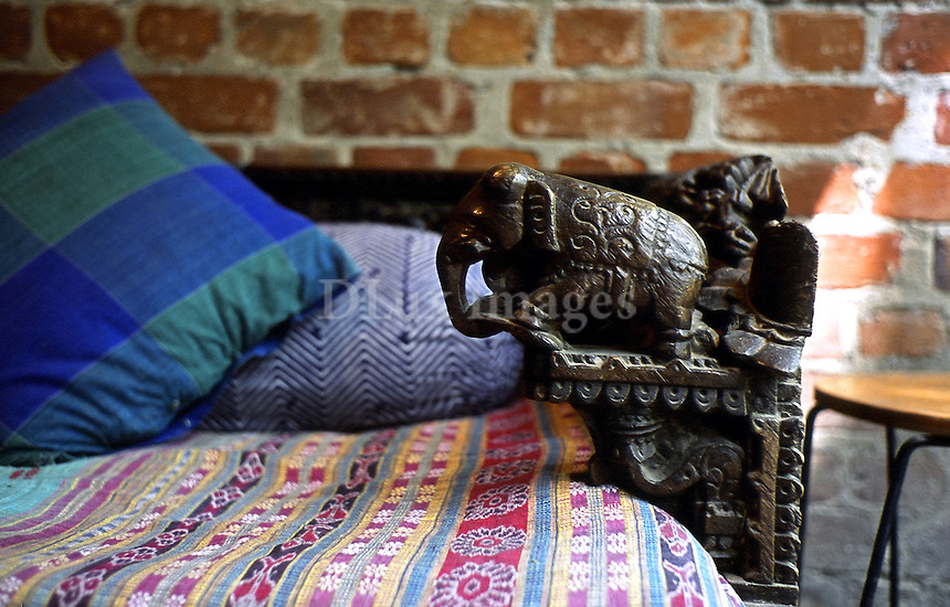indian wooden sculpture over the bed