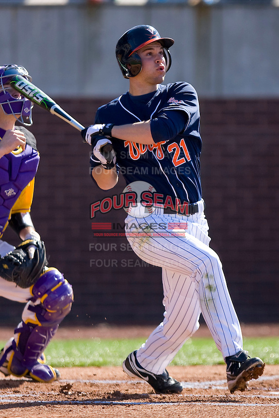Dan Grovatt #21 of the Virginia Cavaliers follows through on his swing versus the East Carolina Pirates at Clark-LeClair Stadium on February 20, 2010 in Greenville, North Carolina.   Photo by Brian Westerholt / Four Seam Images