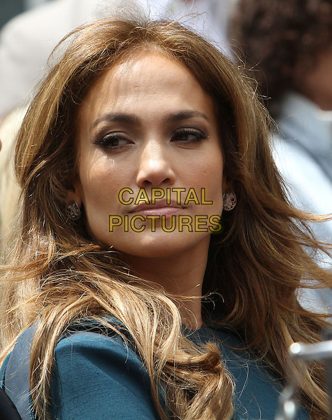 JENNIFER LOPEZ.Simon Fuller Hollywood Walk Of Fame Induction Ceremony  Held On Hollywood Blvd., Hollywood, California, USA..May 23rd, 2011.headshot portrait green blue teal smiling.CAP/ADM/KB.©Kevan Brooks/AdMedia/Capital Pictures.