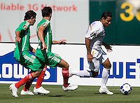 05 July 2009: Wilber Sanchez of the Nicaragua dribbles the ball away from Mexico players during the game at Oakland-Alameda County Coliseum in Oakland, California.    Mexico defeated Nicaragua, 2-0.