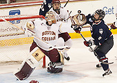 Thatcher Demko (BC - 30), Steve Santini (BC - 6), Spencer Naas (UConn - 8) - The Boston College Eagles defeated the visiting University of Connecticut Huskies 3-2 on Saturday, January 24, 2015, at Kelley Rink in Conte Forum in Chestnut Hill, Massachusetts.