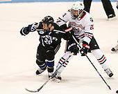 Kyle Schmidt (Bentley - 20), Nolan Stevens (NU - 21) - The visiting Bentley University Falcons defeated the Northeastern University Huskies 3-2 on Friday, October 16, 2015, at Matthews Arena in Boston, Massachusetts.