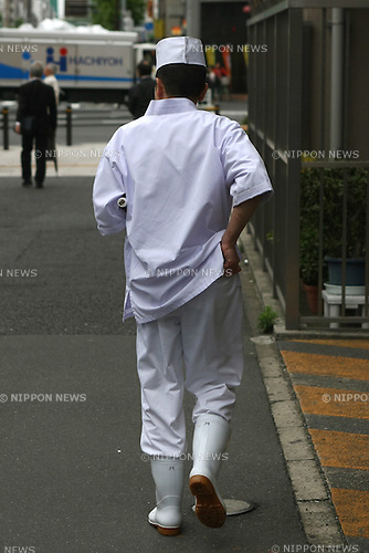 "May 19, 2010 - Tokyo, Japan - A chief enters a Nihonkai Shoya restaurant in Tokyo, Japan, on May 26, 2010. Nihonkai Shoya and its four top managers were ordered Tuesday to pay about 78.6 million yen in damages to the parents of an employee who died of overwork in August 2007. The Kyoto District Court's decision was the first to find the top management of a major business corporation liable to pay damages in a suit involving death by overwork, or ""karoshi"". Motoyasu Fukiage, 24, died from acute heart failure after working an average of 112 hours of overtime per month."