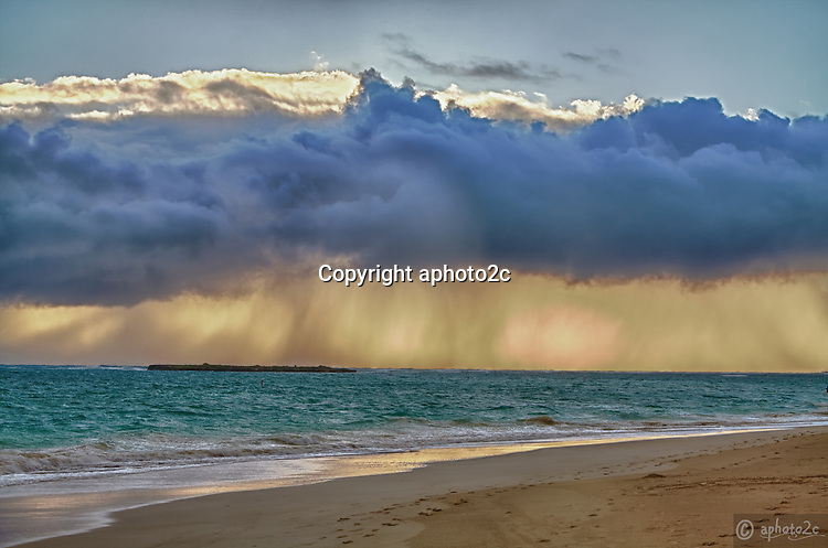 Morning sunrise with rain over Flat Island in Lanikai Beach