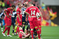 MELBOURNE, AUSTRALIA - JANUARY 09: Cameron Watson of United looks on while his team mate receives treatment and the referee shows Kevin Muscat of the Victory a red card during the round 22 A-League match between the Melbourne Victory and Adelaide United at AAMI Park on January 9, 2011 in Melbourne, Australia. (Photo by Sydney Low / Asterisk Images)