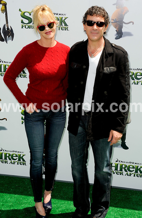 **ALL ROUND PICTURES FROM SOLARPIX.COM**.**SYNDICATION RIGHTS FOR UK, AUSTRALIA, DENMARK, PORTUGAL, S. AFRICA, SPAIN & DUBAI (U.A.E) & ASIA (EXCLUDING JAPAN) ONLY**.Shrek Forever After, Los Angeles Premiere - Arrivals, Gibson Amphitheater / Universal City, CA. USA.This pic: Antonio Banderas and Melanie Griffith.JOB REF: 11264    PHZ ortega    DATE: 16_05_2010.**MUST CREDIT SOLARPIX.COM OR DOUBLE FEE WILL BE CHARGED**.**MUST NOTIFY SOLARPIX OF ONLINE USAGE**.**CALL US ON: +34 952 811 768 or LOW RATE FROM UK 0844 617 7637**