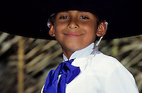 Portrait of a mexican boy in traditional dress with a big hat and a big smile
