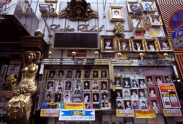 10/10/2003--Tokyo, Japan..The outside of the 'Lady's Club', a male host bar in Tokyo's seedy Kabukicho district, shows photographs of all the men available to women clients...All photographs ©2003 Stuart Isett.All rights reserved.