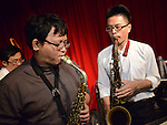 Boplicity, Tainan -- Jeffry Lin, saxophonist of Smalls Jazz Combo, with guest saxophonist on stage.