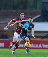 Matt Bloomfield of Wycombe Wanderers holds off Peter Murphy of Morecambe during the Sky Bet League 2 match between Wycombe Wanderers and Morecambe at Adams Park, High Wycombe, England on 2 January 2016. Photo by Andy Rowland / PRiME Media Images