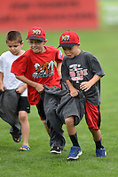 Batavia Muckdogs on field promotion, the three legged race, during the first game of a doubleheader against the Connecticut Tigers on July 20, 2014 at Dwyer Stadium in Batavia, New York.  Connecticut defeated Batavia 5-3.  (Mike Janes/Four Seam Images)