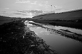 Juarez, Mexico.May 19, 2008<br /> <br /> Life along the US/ Mexican - El Paso/Juarez border from the Mexican side. A trickle of water remains in the Rio Bravo - Rio Gande as the US diverts 75% for irrigation and the Mexicans divert the other 25%. The river itself is the US/Mexican border line.