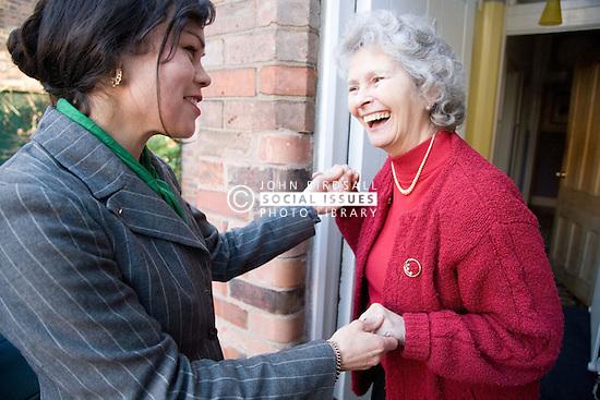 Older woman greeting an IndependentAge volunteer at her front door,