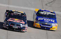 May 30, 2008; Dover, DE, USA; Nascar Craftsman Truck Series driver Scott Speed (22) passes Ron Hornaday Jr (33) during the AAA Insurance 200 at Dover International Speedway. Mandatory Credit: Mark J. Rebilas-US PRESSWIRE.