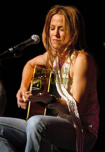 SHERYL CROW.Rock for Choice Benefit Concert held at The Hollywood Palladium in Hollywood, California .23 January 2004       .*UK Sales Only*                                           .music, gig, live, playing guitar                                    .www.capitalpictures.com.sales@capitalpictures.com.©Capital Pictures.