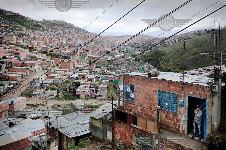 A man looks out from his shack with a view over the slum area of Soacha, south of Bogota. Most of the people who live here are IDPs.This story by Mads Nissen was partly funded by a grant and when published it should be credited: Funding for this project was provided by the Manuel Rivera-Ortiz Foundation for International Photography.