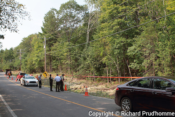 A body is found along the edge of the forest along Vincent-Massey road in Rawdon, Quebec