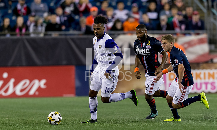 Foxborough, Massachusetts - September 2, 2017: First half action. In a Major League Soccer (MLS) match, New England Revolution (blue/white) vs Orlando City (white), at Gillette Stadium.