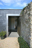 The ancient flint-set stone walls have been integrated into the design of the house and have been fully restored